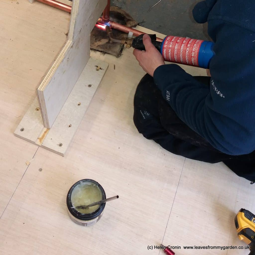 tim-hard-at-work-soldering-the-copper-pipe-work-for-the-archway