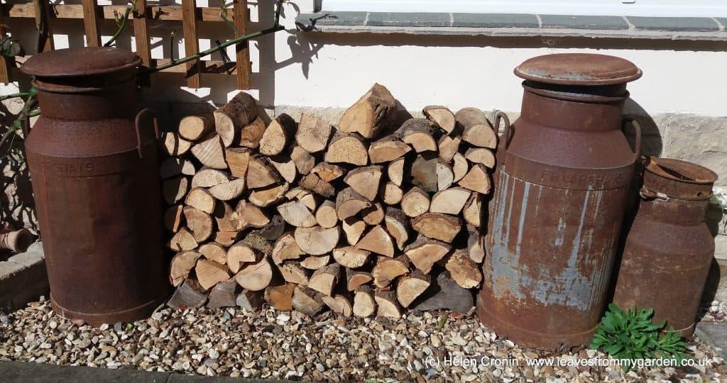 Wood stacked between milk churns