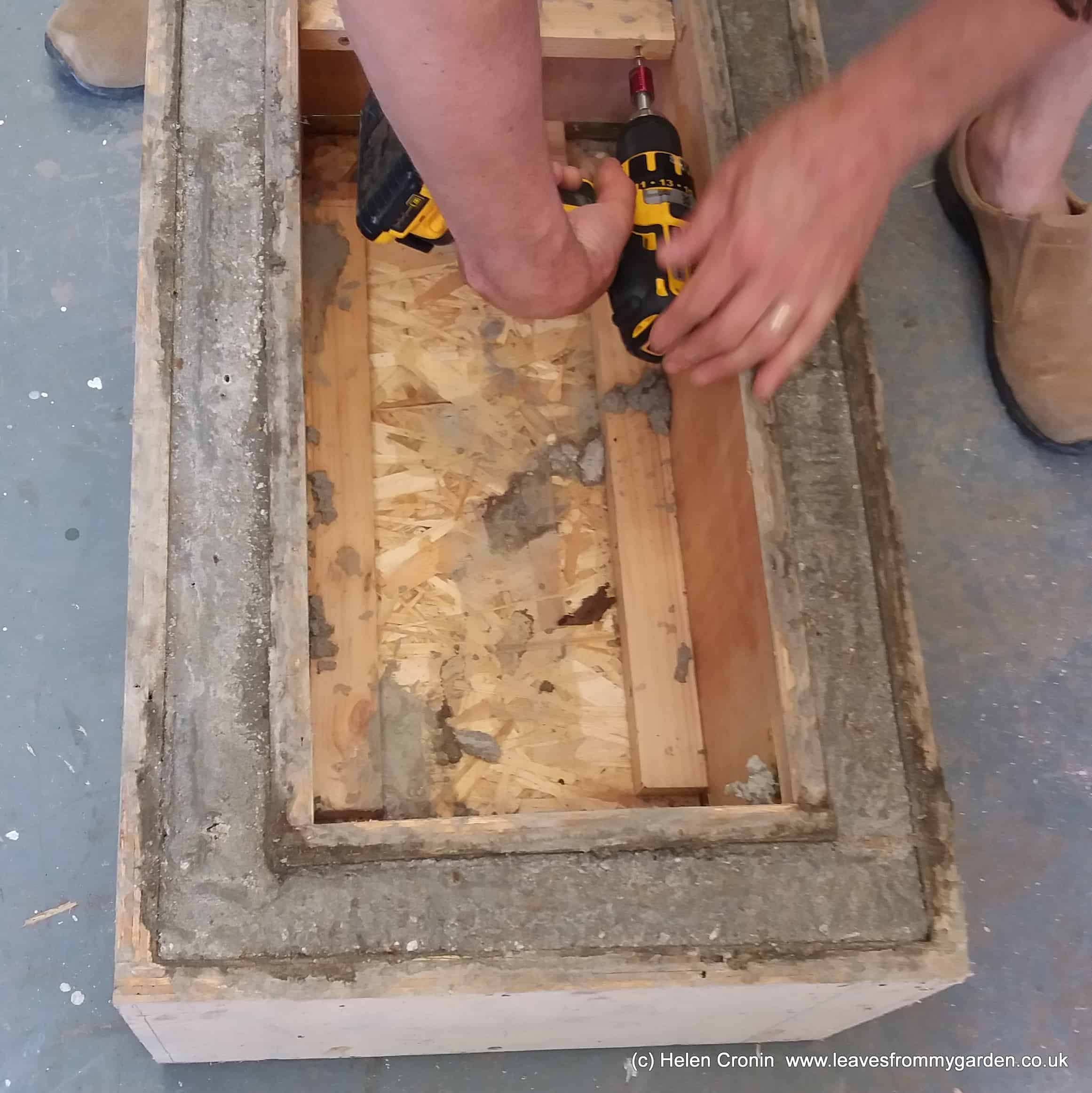 Deconstructing the wooden boxes for the hypertufa trough at www.leavesfrommygarden.co.uk